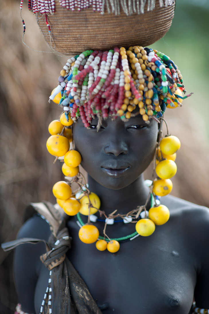 Young Mursi tribal woman